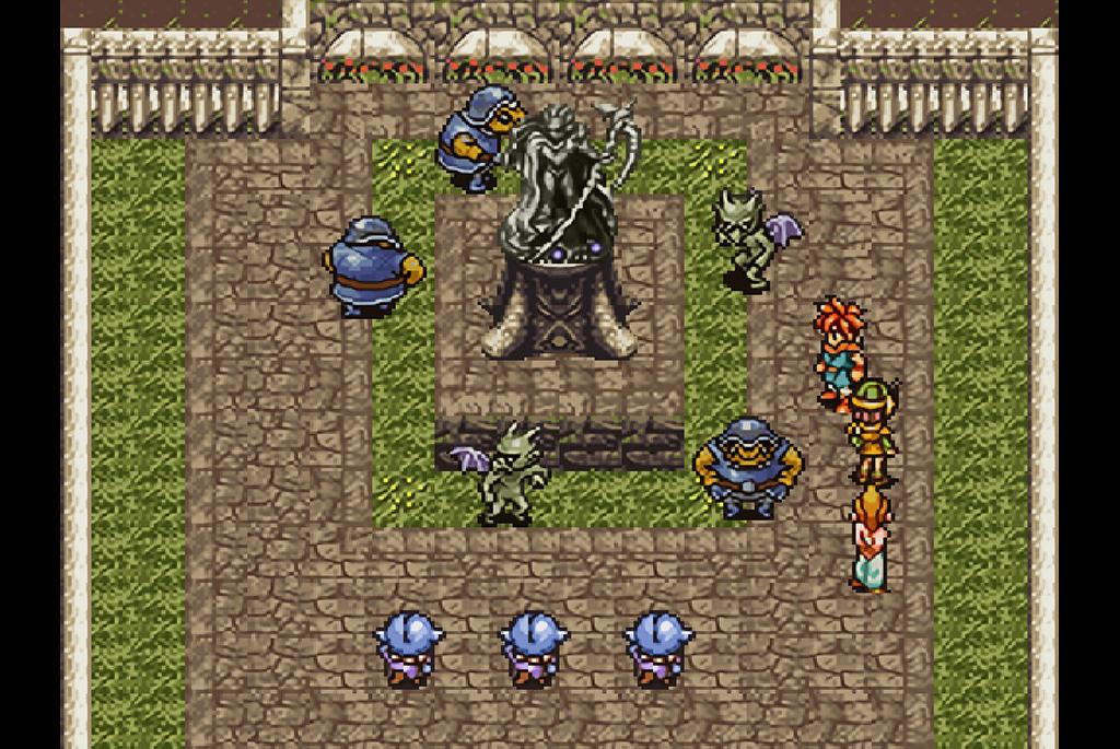 魔王の像を囲んで祈りを捧げる魔物たち